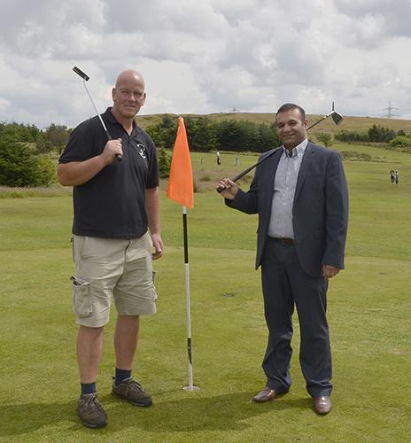 Mark Cumiskey with Councillor Shoab Akhtar